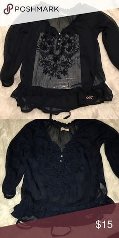 Hollister Polyester shirt with lace flowers Super cute☺️ brand new condition. Navy blue. Paper under shirt in photo to better see flowers and buttons Hollister Tops