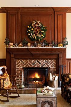 Contrasting flickering embers, a snowy village beckons visitors to the mantel for a closer look. Christmas Fireplace, Cozy Christmas, Fireplace Mantel, Saltbox Houses, Victoria Magazine, Interior Decorating, Holiday Decorating, Christmas Decorations, Living Room Decor