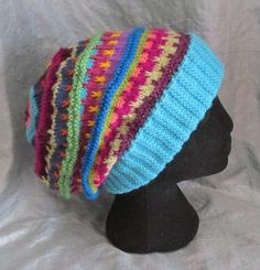 This is a pattern for a textured loose-fitting slouch hat or beanie using scraps of different coloured yarn. This is a great stashbuster pattern! The pattern is written out in full for an adult slouch hat, knitted flat, but options are also given for any other size (from toddler to