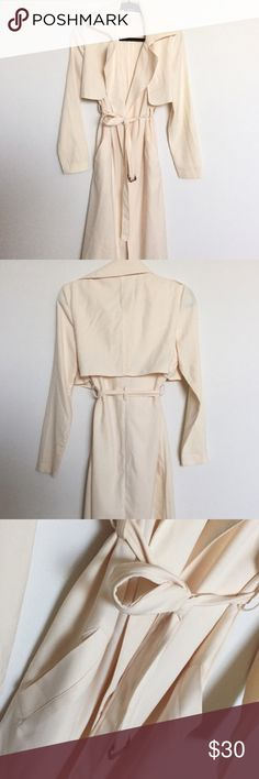 Missguided Longline Belted Jacket Worn once and just wasn't my style but it's a beautiful jacket!!! Can be worn to dress up or dress down. Light weight has pocket and adjustable belt. Cream color perfect for layering!! UK size 6 US size 2 Missguided Jackets & Coats Trench Coats