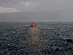 Swimming in a huge storm. National Geographic Traveler 2012