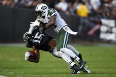 Michael Crabtree #15 of the Oakland Raiders is hit by Antonio Cromartie #31 of the New York Jets during their NFL game at O.co Coliseum on November 1, 2015 in Oakland, California. (Oct. 31, 2015 - Source: Thearon W. Henderson/Getty Images North America)