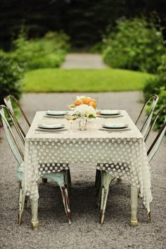 This is slightly a little too country for my taste but I'm falling hard for the idea of sheer polka dot tablecloths - swoon!