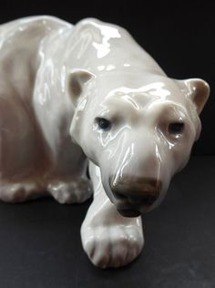This is a fabulous and highly collectable porcelain figure of a polar bear.  It dates from the 1940s and was modelled by Knud Kyhn.  It is fully back stamped and signed below.  As you can see Kyhn has perfectely captured the bear striding about in the Artic. In excellent condition with no damages.  He a large size and looks great on display. He is 10 1/2 inches in length and about 6 1/2 inches in height.  Sadly, both the size and weight would restrict this to UK posting only.