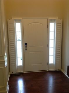 Install Shutters That Open Up For A Clear View When You Want To See Out Your Sidelights