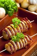 potato skewers with bacon - stock photo