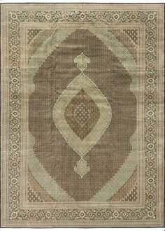 This antique Persian Tabriz rug is simple yet evokes a sense of history. Available at Dallas Rugs, Dallas, Tx.