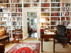 I like the white bookshelves with brown/wood furniture and that the bookshelves are on the wall with the door