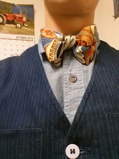 Butcher and Tweed funky fall colored paisley bow tie on Key chambray on Butcher and Tweed pinstripes.