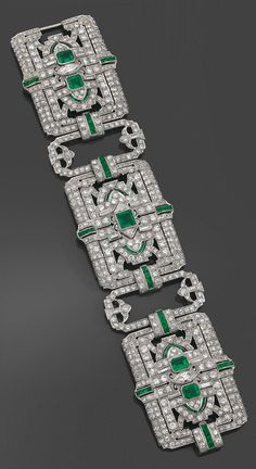 A rare and spectacular Art Deco platinum, diamond and emerald bracelet, by Yard, circa 1925. The articulated bracelet composed of three broad, openwork plaques, joined by openwork links, set with diamonds and emeralds, mounted in platinum. Signed. #RaymondYard #ArtDeco #bracelet