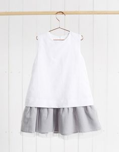 Fashionable white linen party dress complimented with a grey tulle underskirt, tied with a bow at the back neckline. Little Girl Fashion, Little Girl Dresses, Toddler Fashion, Toddler Outfits, Kids Outfits, Kids Fashion, Girls Dresses, Simple Dresses, Cute Dresses