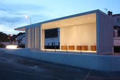 intercity bus stop shelter | Mercedes López | Archinect;  a little too open for what our program requires, but I love the placement of the lights in what looks to be a simple and tranquil space. I am assuming that those brown box looking objects are seating of a sort. Atypical when compared to the common bench.