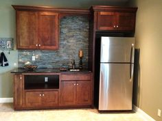 {Basement kitchenette with gorgeous stacked stone} Would add oven/range and a wrap-around counter.