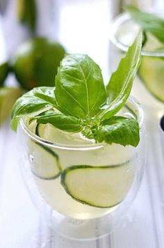 Cucumber Basil Gin and Tonic.  I have never even liked gin but this summer cocktail is so refreshing and delicious that it's a new favorite of mine! | blog.hostthetoast.com