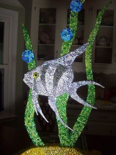 free standing art sculpture done in rhinestones with an LED flute light attached at the base to illuminate it at night. For sale $375.