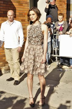 Keira Knightley Pumps  Keira Knightley teamed her textured Valentino halter dress with pheasant feathered ankle strap heels from the Fall 2011 collection.  Brand: Valentino