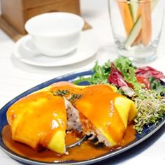 Omurice, consisting of an omelette made with fried rice and usually topped with ketchup.