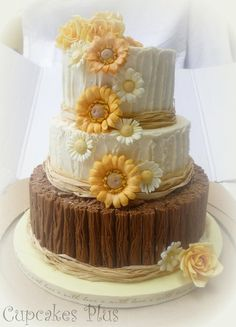 Wedding Cake-- change the sun flowers to spring garden...love the look of the log bottom layer...  :)