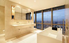 18 West India Quay, Canary Wharf    This fabulous master ensuite bathroom has stunning views across London.    Price: £2,250,000    Agent: Chesterton Humberts, www.chestertonhumberts.com 020 7510 8300