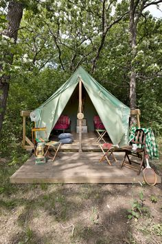 Guests can hang out in a platform tent, like this one, outfitted with cots, folding chairs, and coolers. Cabins and the bunkhouse range from $550 to $1,000 a night with a two-night minimum.          - CountryLiving.com