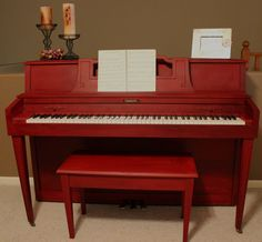 I used chalk paint and dark wax to paint my piano red. I adore it!