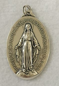 "The Large Miraculous Medal sacramental medal in Sterling Silver, White Bronze, & Brass Bronze. Size:  2"" X 1.5"" , Display your faith!"
