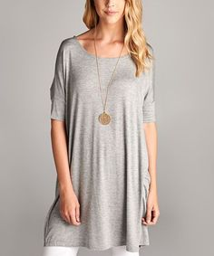 Invigorate your look with the breezy design of this sleek top that features an extra-long silhouette for a touch of on-trend allure. An allover hue offers easy-pair appeal. Necklace not included95% rayon / 5% spandexHand wash; hang dryImported