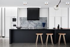 WOW @fionalynchoffice . The Williamstown House in Melbourne combined concrete , solid oak and stone photography @_danhocking_ styling @marshagolemac ✨✨| #love #kitchen #melbourne #interiordesign #concrete #stone #luxury
