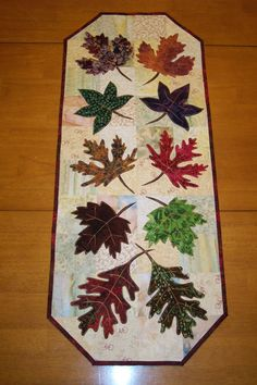 "Leaf Table Runner, Quilted Table Runner, Batik Fabric Table Runner 14 x 34"". $60.00 USD, via Etsy."