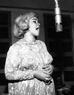 In her heyday: Etta James pictured around 1970 singing with her distinctive and powerful voice
