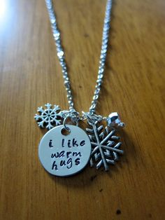 """Disney's Frozen Inspired Elsa's friend Olaf Necklace """"I like warm hugs"""" by WithLoveFromOC, $20.00 and FREE shipping. Snowflake charms and a crystal charm."""