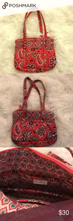 Vera Bradley Bag Used Vera Bradley bag is Great condition. Please view photos, asked questions and/or make reasonable offer. The size is small/medium it's not a mini size. Multiple compartments for cell phone, wallet, sunglasses, mirror compact and more. Very nice for an on the go run and stylish. Vera Bradley Bags Totes