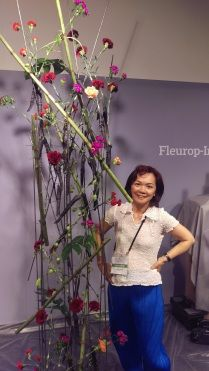"""Fleurop - Interflora World Cup Berlin Day 1, Surprise Assignment called """"100% Dianthus"""". Check out this design by Malaysian competitor Caroline Loo Sooi Hing, making off and interview on www.flowerweb.com..."""