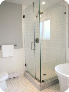 Glass tile shower, hexagonal tile floor, beadboard