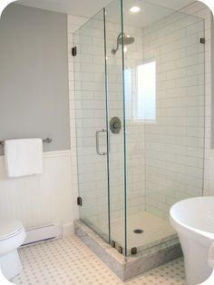 Glass tile shower, hexagonal tile floor, beadboard
