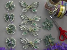 Origami money butterfly. Origami money fan. Origami money flower. The circles are one bill,  the butterfly is two bills and the flower is three bills. 3 butterflies, 3 flowers and 5 fans= $20