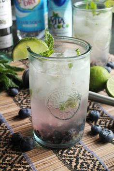 Blueberry Coconut Mojitos | I love a good fruited mojito. My latest version incorporates both coconut and blueberry. Cheers!