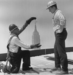 Construction workers on the 59th floor of the Pan American Building in New York. The Empire State building is seen in the background, 1962.(Getty Images)