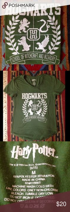 Harry Potter Hogwarts Tee ⚡️⚡️Re-posh. Doesn't fit me  trying to get my money back! It's a size M but it's juniors (size 15) and fits really small. Harry Potter Tops Tees - Short Sleeve
