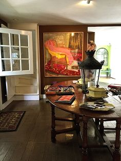 Antique lantern & gate-leg table mixed with wonderful contemporary art piece in entry to Nantucket cottage of designer Cynthia Everets