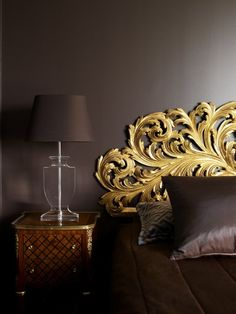 Bedroom - Greg Natale | Sydney based architects and interior designers. Gorgeous lamp, bedside table, Gold Headboard!.