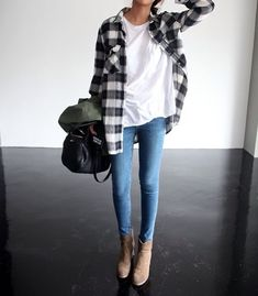 Layer an open plaid shirt over a white tee and jeans. Pair the look with booties as we head into fall.