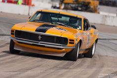 Jim Hague power slides his 1970 Ford Boss 302 Mustang out of turn 11.