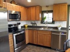 We love this simple, charming kitchen. The Cliqstudios.com Dayton kitchen cabinets in Maple Caramel are shown.