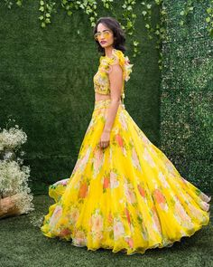 Double the floral double the fun . Stunning yellow color lehenga and cropt tops. Lehenga with floral print and tops with floral hand embroidery work. Alice in Bohemia Indian Gowns Dresses, Indian Fashion Dresses, Indian Designer Outfits, Indian Outfits, Frock Fashion, Prom Dresses, Long Dress Design, Stylish Dress Designs, Stylish Dresses