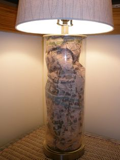 i made this lamp with a fillable lamp from target and a crumpled map of paris