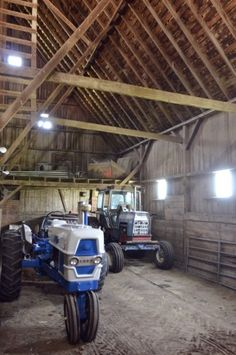 Barn With Tractors Parked Inside