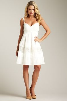I am such a sucker for white lacy summer dresses with a sweetheart neckline .... so pretty
