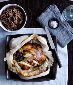 Invoking ancient cooking techniques, Janni Kryistsis bakes a whole chicken with pancetta, mushrooms and barley in clay to seal the juices in. It also lends itself to a theatrical dinner table reveal.