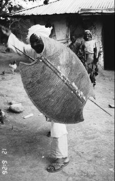 Man holding a mambila shield. Nigeria 1993